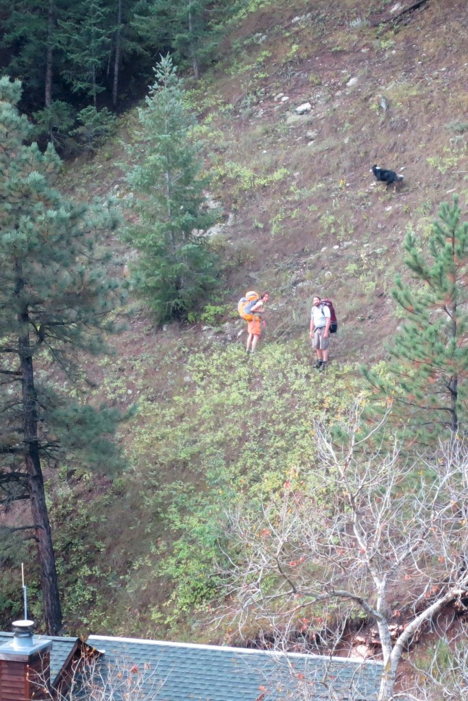 This couple, and their pup, were on the southwest (wrong) side of the creek. They did find a bridge, though, and (I think) hiked successfully into town.