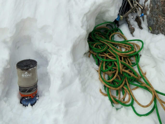 """My JB, at a belay on RMNP's """"Fields Chimney"""". Note that the fuel can is sitting in the little plastic cup, which has bit of liquid water in it. This mitigates heat exchange with the environment, and helps keep the fuel in gas form."""